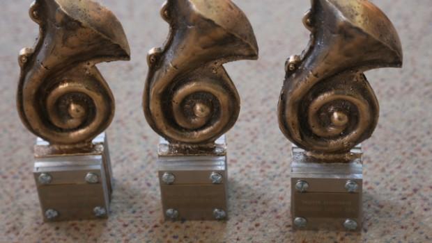 Trzy statuetki MUG 2014